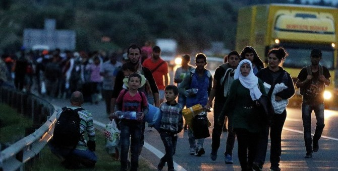 Syrian refugees walking along a Hungarian highway en route to Austria. (AP)