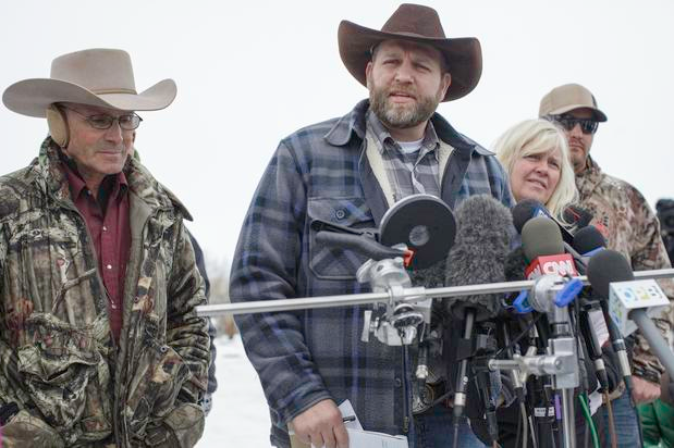 Ammon Bundy speaking to reporters with Finicum on his right.