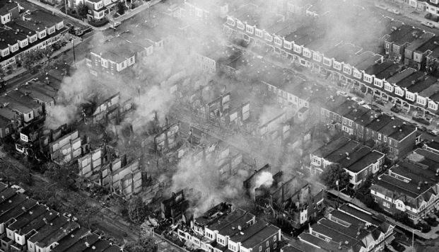 Destruction of a predominantly African American block in the aftermath of the MOVE bombing that left 11 people dead and another 250 homeless.