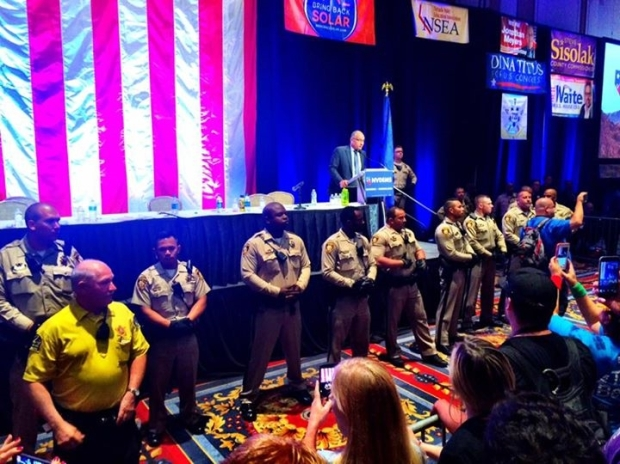 Scuffles among the crowd prompted a heavy police presence with Las Vegas police officers lining the stage, though the convention saw no arrests.