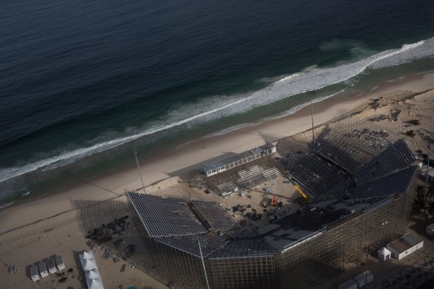 Aerial shot of the unfinished Olympic beach volleyball stadium on the Copacabana Beach that was taken in June. (Credit Rafael Fabres for The New York Times)