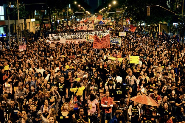 Thousands of educators and their supporters flooded the streets of Rio de Janiero demanding better working conditions and wages. (AFP)