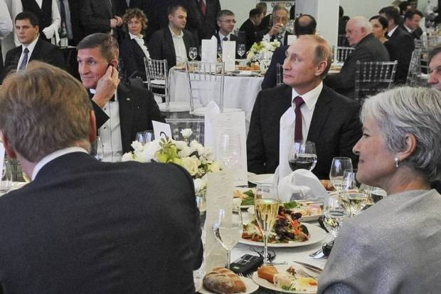 Michael Flynn (left) and Vladimir Putin (right). Former Green Party presidential candidate Jill Stein can also be spotted in the lower right-hand corner. (Michael Klimentyev/Sputnik via Associated Press))